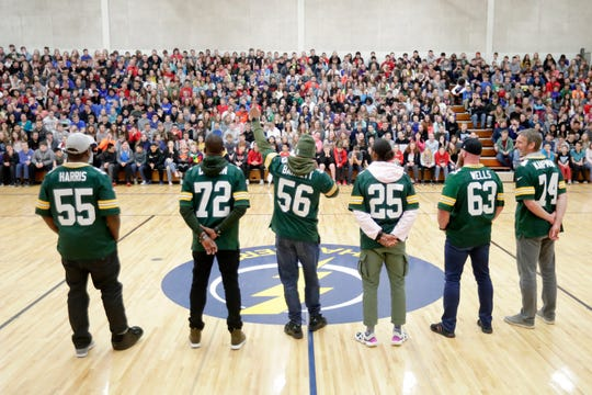 Former Green Bay Packers players talk to students during a stop on the Packers Tailgate Tour at Ben Franklin Junior High High School on Tuesday, April 9, 2019 in Stevens Point, Wis.