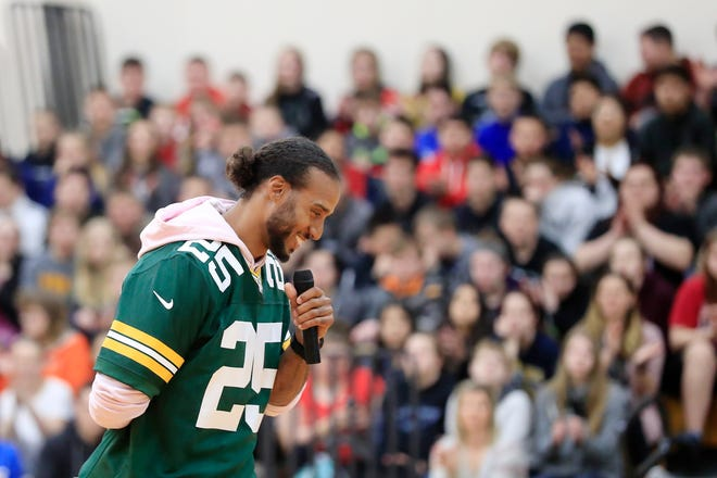 Former Green Bay Packers player Ryan Grant speaks during a stop on the Packers Tailgate Tour at Clintonville High School on Tuesday, April 9, 2019.
