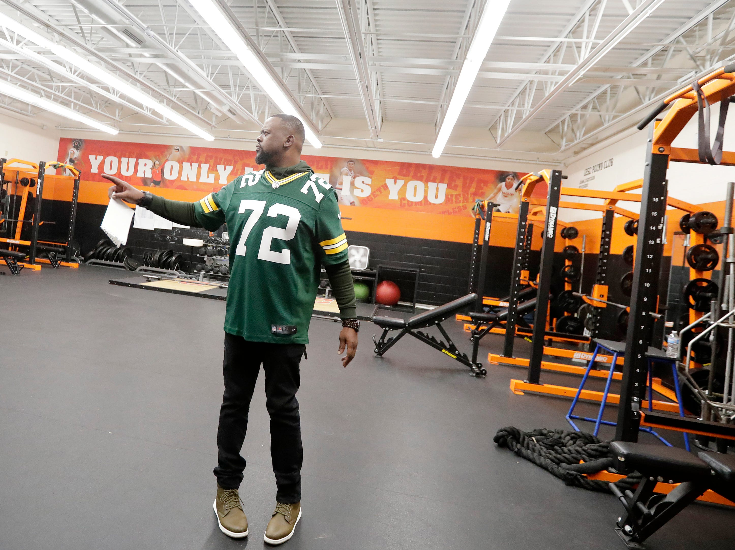 Former Green Bay Packers player Earl Dotson checks out the weight room during a stop on the Packers Tailgate Tour at Clintonville High School on Tuesday, April 9, 2019 in Clintonville, Wis.