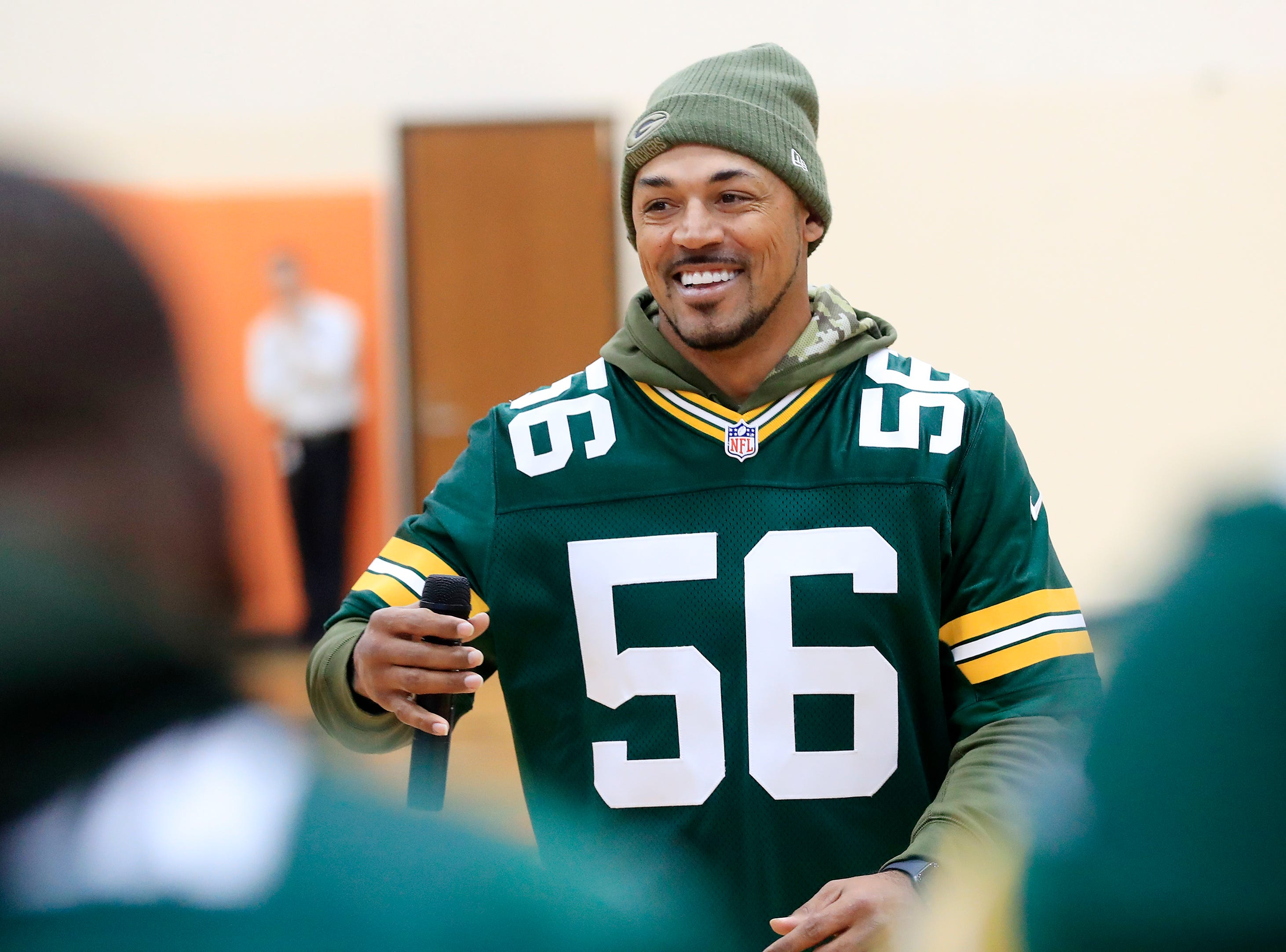 Former Green Bay Packers player Nick Barnett speaks during a stop on the Packers Tailgate Tour at Clintonville High School on Tuesday, April 9, 2019 in Clintonville, Wis.