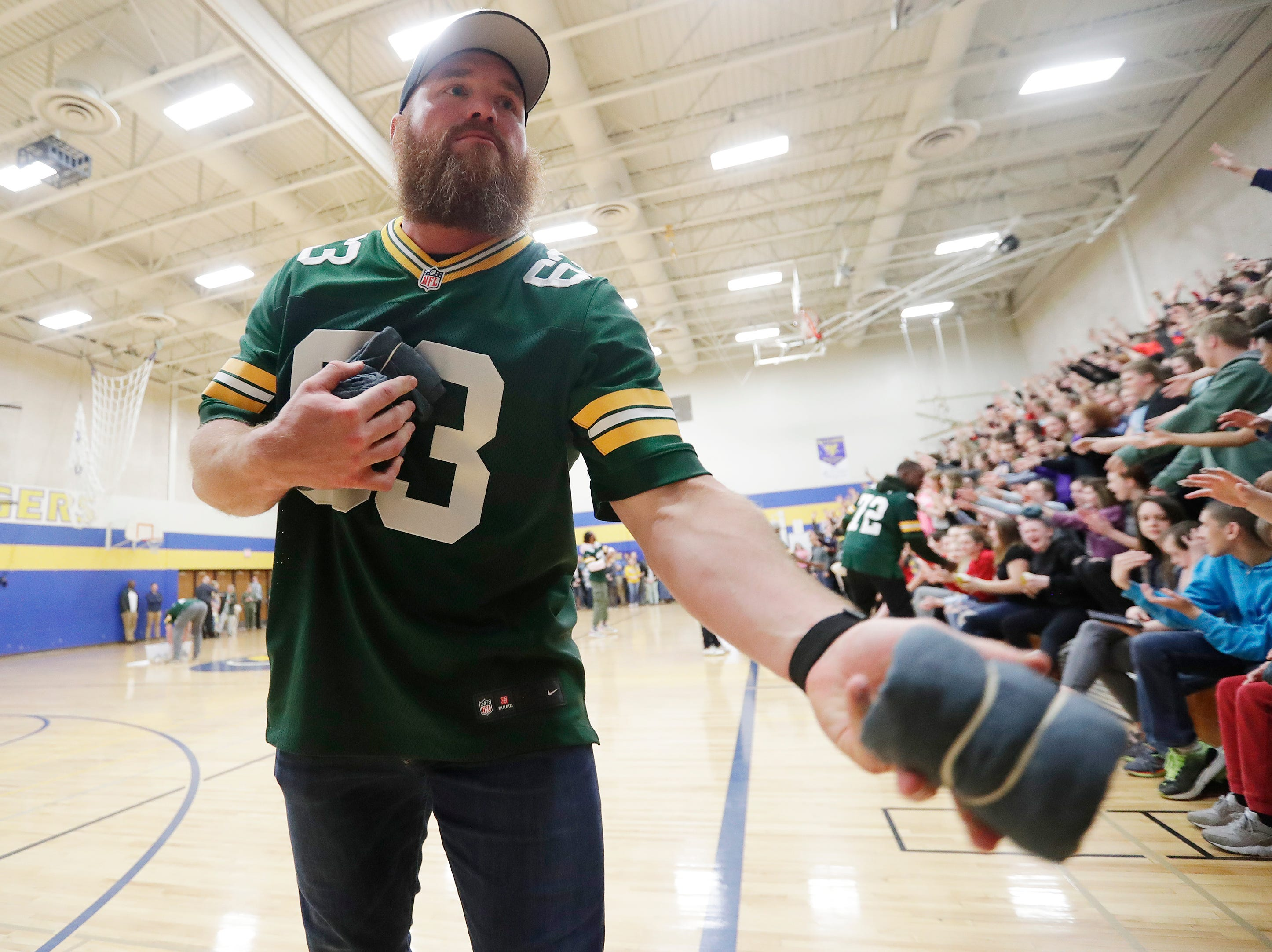 Former Green Bay Packers player Scott Wells hands out shirts during a stop on the Packers Tailgate Tour at Ben Franklin Junior High High School on Tuesday, April 9, 2019 in Stevens Point, Wis.