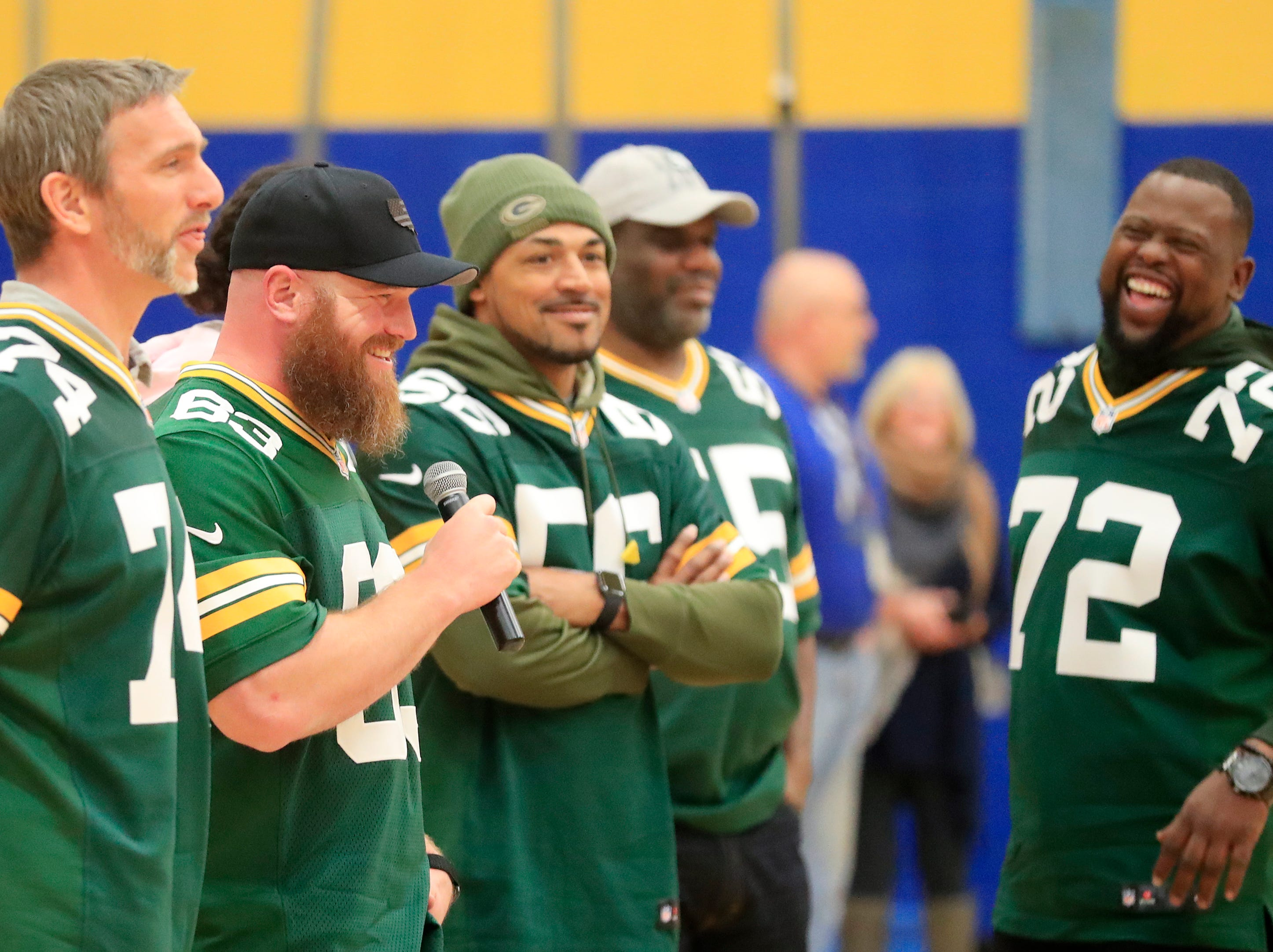 Former Green Bay Packers player Scott Wells talks during a stop on the Packers Tailgate Tour at Ben Franklin Junior High School on Tuesday, April 9, 2019 in Stevens Point, Wis.