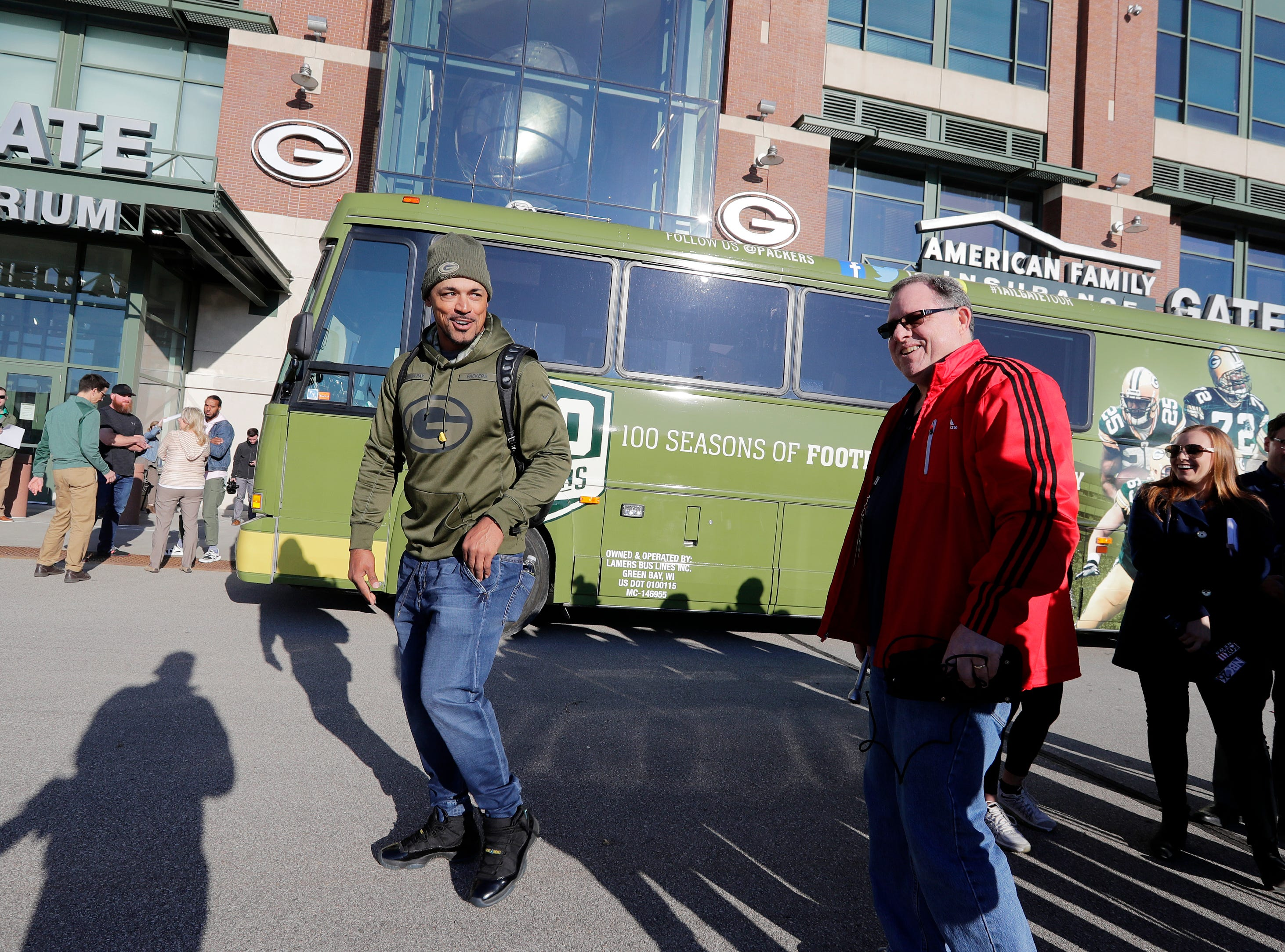 Former Green Bay Packers player Nick Barnett boards the bus for the Packers Tailgate Tour at Lambeau Field on Tuesday, April 9, 2019 in Green Bay, Wis.