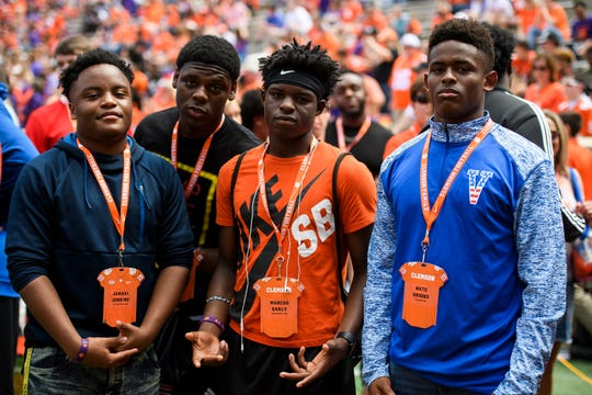 From left, Clemson recruits Jamari Jenkins, Willie Northern, Marcus Early and Nate Brooks before the spring game at Memorial Stadium Saturday, April 6, 2019.