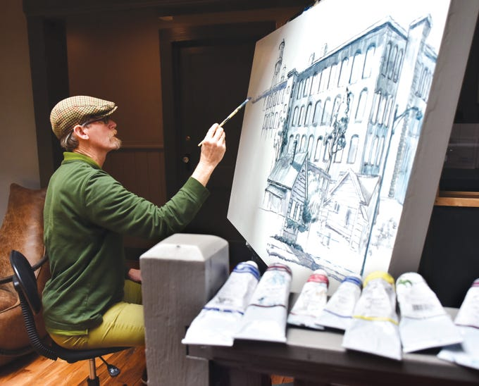 Greenville artist Mark Mulfinger works on a painting at Railside Studios in the West Village.