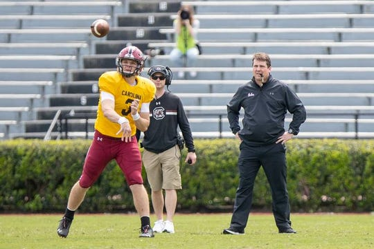 South Carolina head coach Will Muschamp watches the scrimmage from the field as South Carolina's Ryan Hilinski (3) during South Carolina's spring game at Williams-Brice Stadium Stadium Saturday, April 6, 2019, in Columbia, SC.