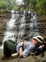"Dave Lotz, author of ""Best Tracks on Guam,"" takes a nap at Tarzan Falls. Lotz's personal running list of hikes consists of nearly 120 trails."