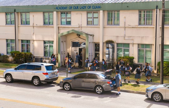 Students exit the Academy of Our Lady of Guam after a day of classes on Tuesday, April 9, 2019.