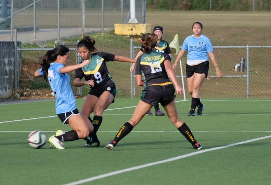 UOG's Ayira Cruz scores against the Venue Sidekicks Sunday in the Guam Football Association Bud Light Amateur Women's League