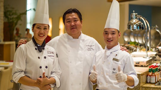 Two chefs from Hanoi are on Guam this week preparing a special Vietnamese lunch buffet at Westin's Taste restaurant. From left: Chef Truong Thi San from Sheraton Hanoi, Executive Chef Sean Jung from The Westin Resort Guam, and Chef Dinh Cong Nhat from Sheraton Hanoi.
