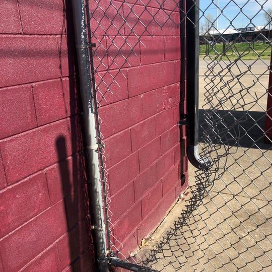 There's a fence with barbed wire at the ReStore offices, but the thief or thieves that took tools from the agency cut through the barrier.