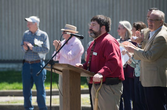 Henderson County Public Library Director Caleb May addresses the crowd during the groundbreaking of their $8 million addition and renovation Tuesday, April 9, 2019.