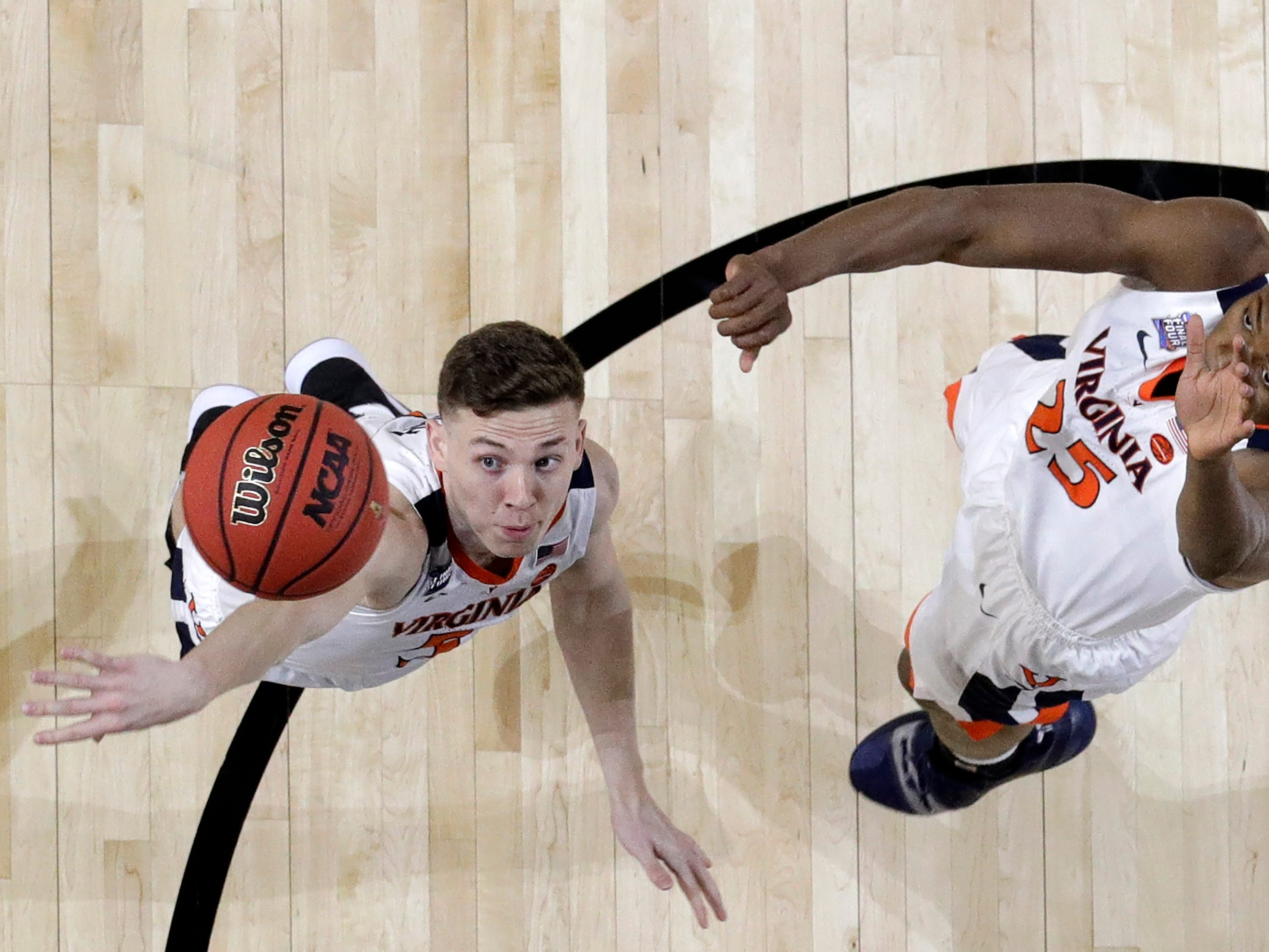 Virginia's Kyle Guy (5) and Mamadi Diakite (25) try to block a shot during the first half in the championship of the Final Four NCAA college basketball tournament against Texas Tech , Monday, April 8, 2019, in Minneapolis.