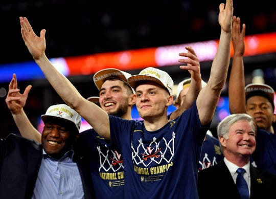 Virginia Cavaliers guard Kyle Guy (5) and guard Ty Jerome (11) celebrates after beating the Texas Tech Red Raiders in the championship game of the 2019 men's Final Four at US Bank Stadium.