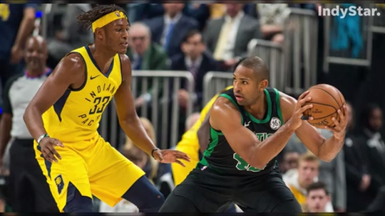 Myles Turner and Domantas Sabonis are in the post for the Indiana Pacers; Al Horford and Aron Baynes are inside for the Boston Celtics.