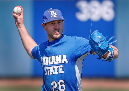 Indiana State University's pitcher Tyler Whitbread warms up with his teammates during practice at Bob Warn Field at Sycamore Stadium in Terre Haute on April 2, 2019.