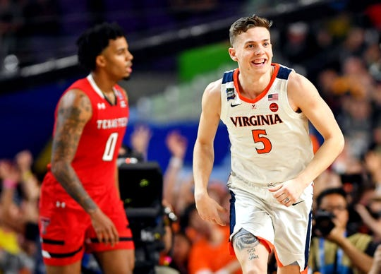 Apr 8, 2019; Minneapolis, MN, USA; Virginia Cavaliers guard Kyle Guy (5) reacts after a play during the second half against the Texas Tech Red Raiders in the championship game of the 2019 men's Final Four at US Bank Stadium.
