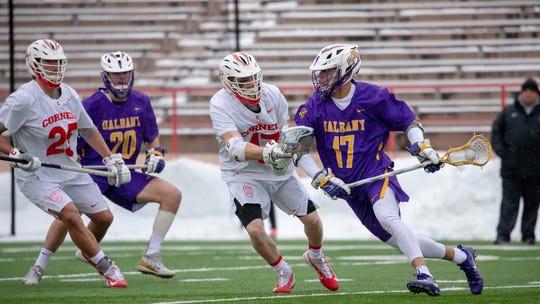 Albany's Jakob Patterson (No. 17) goes on the attack against Cornell's Harrison Bardwell (No. 17) and Fleet Wallace (No. 25) as Albany's Noah Taylor (No. 20) looks on.
