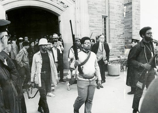 FILE PHOTO Eric Evans, center, who went on to graduate from Cornell in 1969, walks out of Willard Straight Hall along with other members of Cornell?s Afro-American Society, Sunday April 20, 1969. To his left, in the background, is then Cornell President James Perkins. Eric Evans, center, who went on to graduate from Cornell in 1969, walks out of Willard Straight Hall along with other members of Cornell's Afro-American Society, Sunday April 20, 1969. To his left, in the background, is then Cornell President James Perkins.