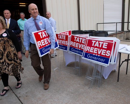 Attendees of Miss. Lt. Gov. Tate Reeves' gubernatorial campaign kick off event at Climate Masters in Pearl, Miss. leave with swag for their yards and businesses. Monday, April 8, 2019.