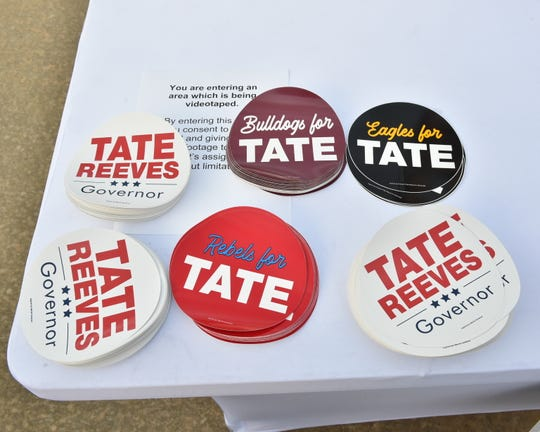 Gubernatorial campaign swag sits on a table outside the kick off event at Climate Masters for Miss. Lt. Gov. Tate Reeves. Pearl, Miss. Monday, April, 8, 2019.
