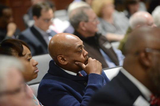 Andre Darnell listens during the April city council meeting in Jackson, Tenn.