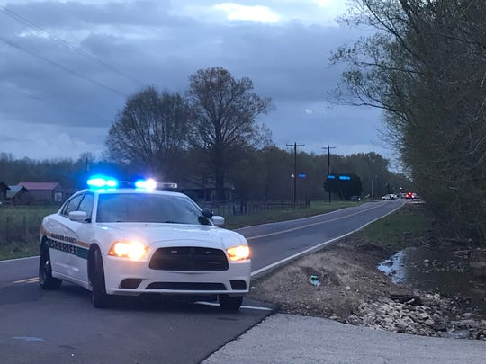 A patrol car blocks part of Perry Switch Road just south of Jackson as Madison County Sheriff's deputies clear the scene after a Monday afternoon standoff.
