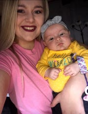 Courtney Stanley holds her daughter Sadie Kaye Stanley. During her pregnancy, Courtney lacked health coverage while suffering from blood pressure problems and extreme swelling.