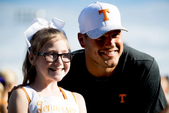 "Molly Stephens, 11, poses for a photo with Colton Underwood before a UT baseball game at Lindsey-Nelson Stadium in Knoxville on Tuesday, April 9, 2019. Underwood of ""The Bachelor"" TV show is working with his Legacy Foundation to give mobile vests to children such as Stephens who have cystic fibrosis."