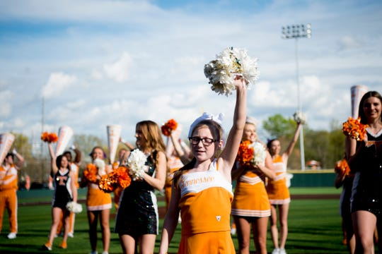 Molly Stephens, 11, cheers with the Spirit Squad before a UT baseball game at Lindsey-Nelson Stadium in Knoxville on Tuesday, April 9, 2019.