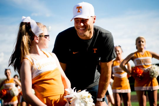 "Molly Stephens, 11, chats with Colton Underwood before a UT baseball game at Lindsey-Nelson Stadium in Knoxville on Tuesday, April 9, 2019. Underwood of ""The Bachelor"" is working with his Legacy Foundation to give mobile vests to children such as Stephens who have cystic fibrosis."