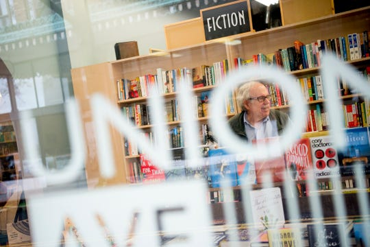 A customer browses the book selection at Union Ave. Books in downtown Knoxville, Tennessee on Tuesday, April 9, 2019.