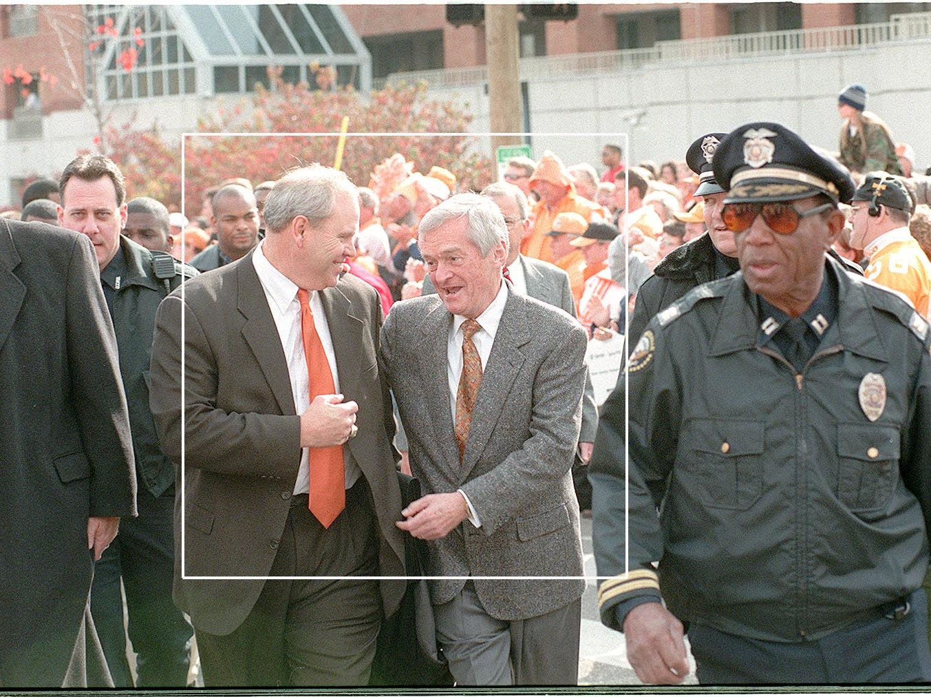 """John Ward talks to head coach Phil Fulmer as they take part in the team """"Vol Walk"""" to the stadium.  1998."""