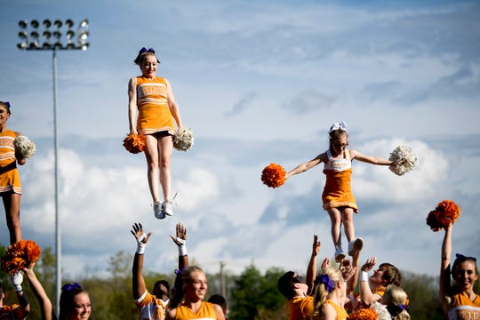 Molly Stephens, 11, does a stunt with the Spirit Squad before a UT baseball game at Lindsey-Nelson Stadium in Knoxville on Tuesday, April 9, 2019.
