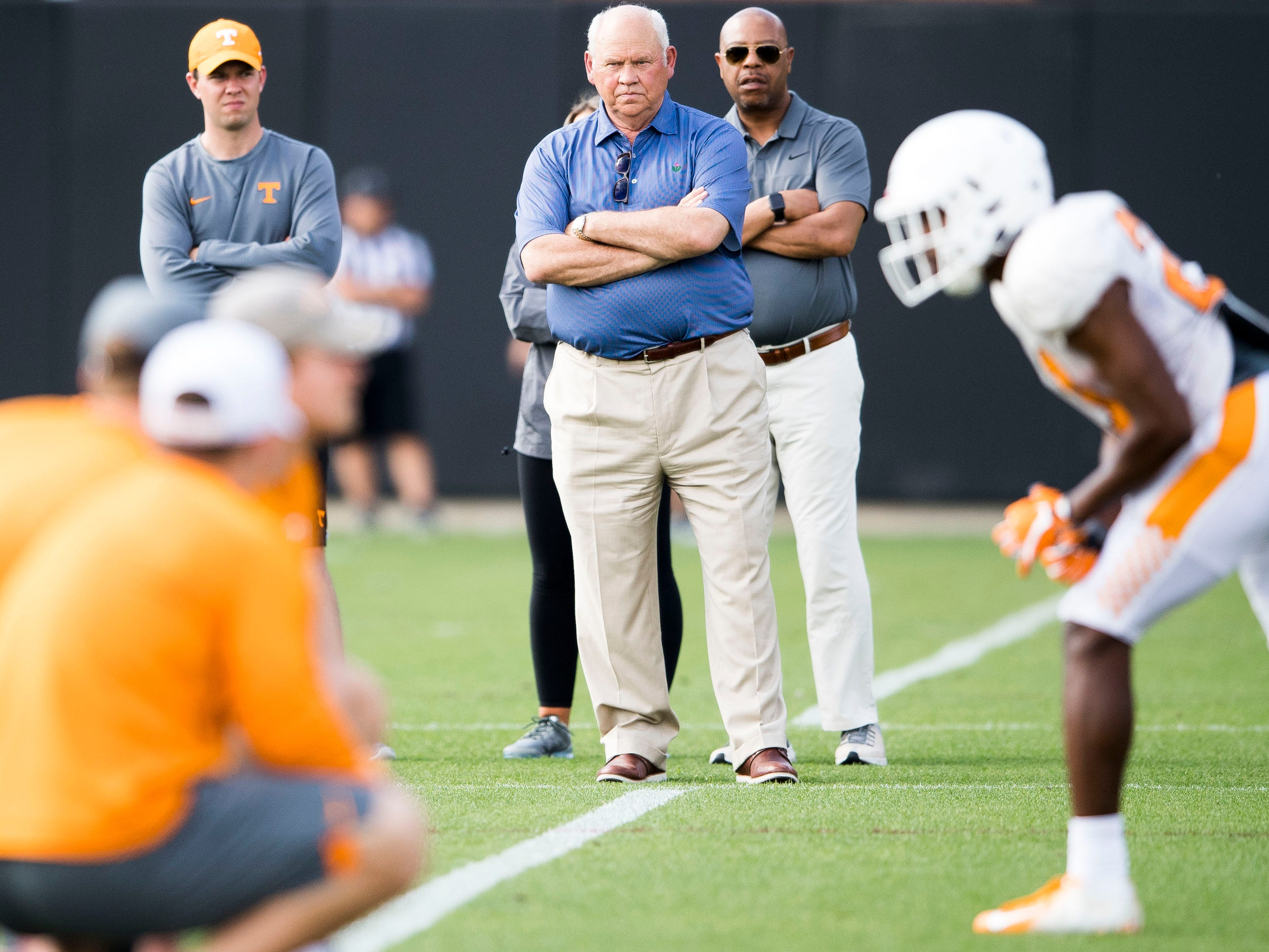 Tennessee athletic director Phillip Fulmer, center, watches the quarterbacks and wide receivers during Tennessee's afternoon football practice on Tuesday, April 9, 2019.
