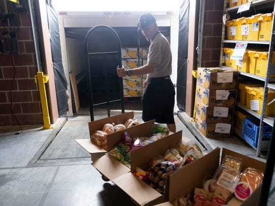 Mark Lamb of Second Harvest collects donated foods at the Kroger Marketplace on Emory Road on Tuesday, April 9, 2019. Kroger is working to eliminate both hunger and food waste through an initiative called Zero Hunger Zero Waste and is donating foodstuffs to organizations like Second Harvest.