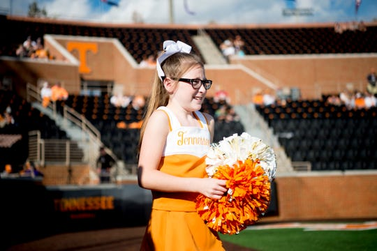 Molly Stephens, 11, takes the field in a Tennessee cheerleader outfit before a UT baseball game at Lindsey-Nelson Stadium in Knoxville on Tuesday, April 9, 2019.
