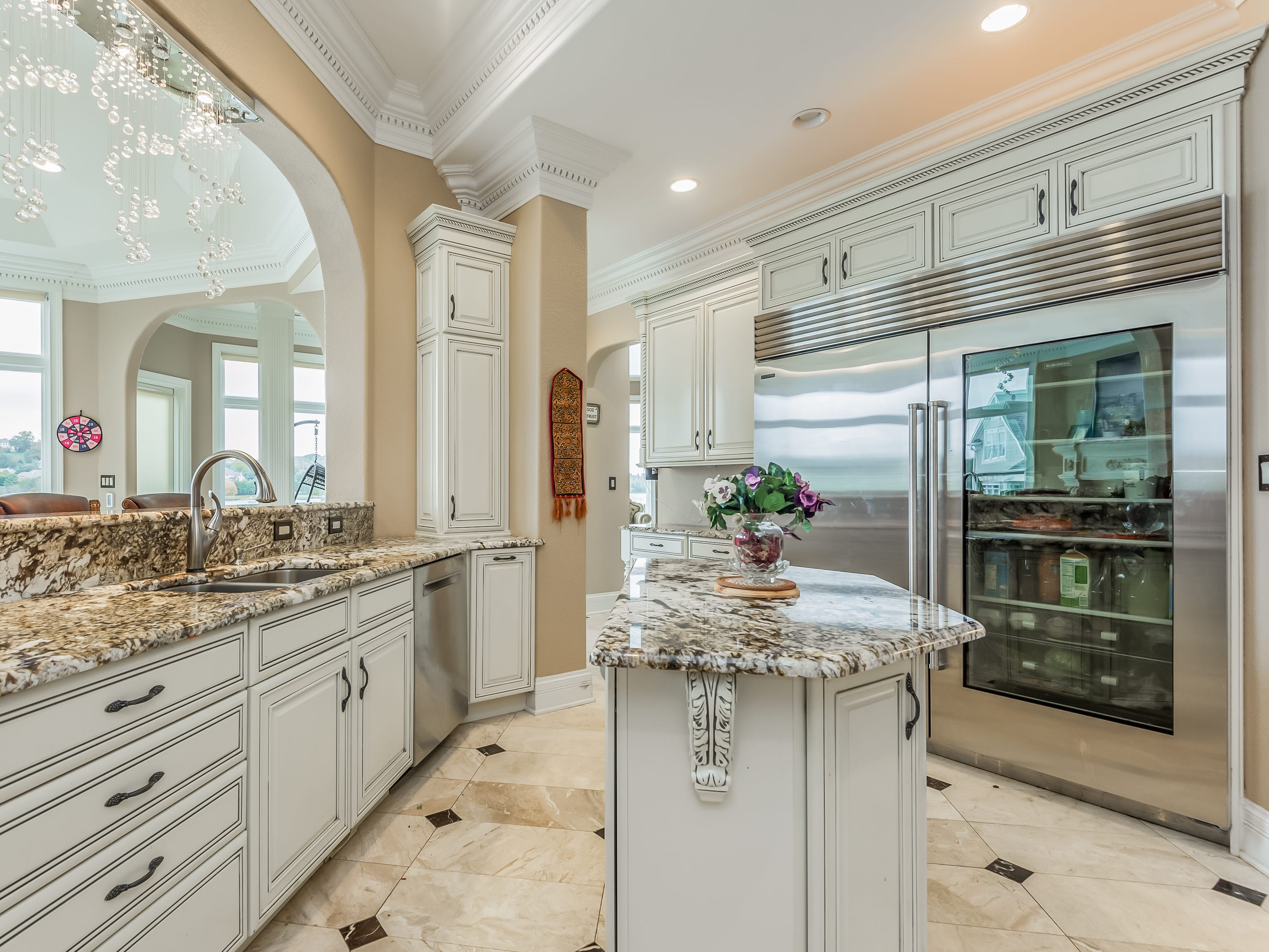 The kitchen includes a subzero fridge and upgraded appliances.