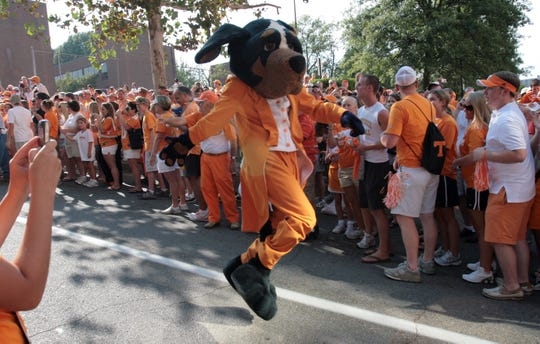 Smokey dances down the street during the Vol Walk before the football game against Southern Mississippi on Saturday at Neyland Stadium. The Vols won 39-19, improving their season record to 1-1.   (Photo special to the News Sentinel by Chad Greene)