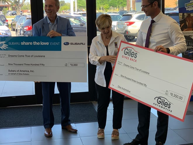 Chairman of Giles Automotive, Inc. Bob Giles, left, and President of Giles Automotive, Inc. Ryan LeBlanc, right, present checks to Dreams Come True Executive Director Becky Prejean.