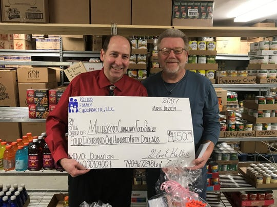 Glen Keller (left) presents check to Les Smith (right) for Millersport Community Food Pantry.