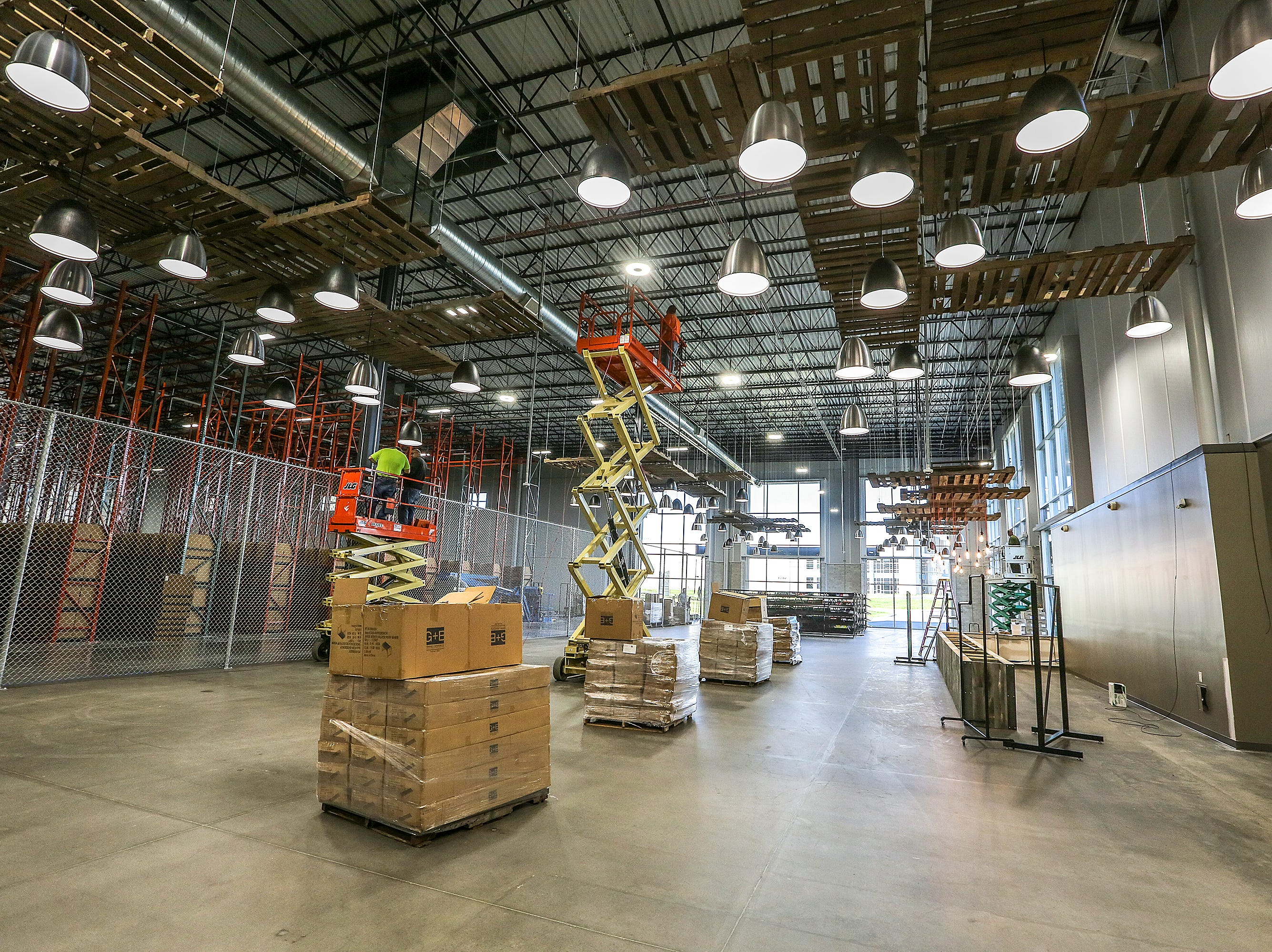 Workers are preparing the new Zappos facility on Minors Lane. 