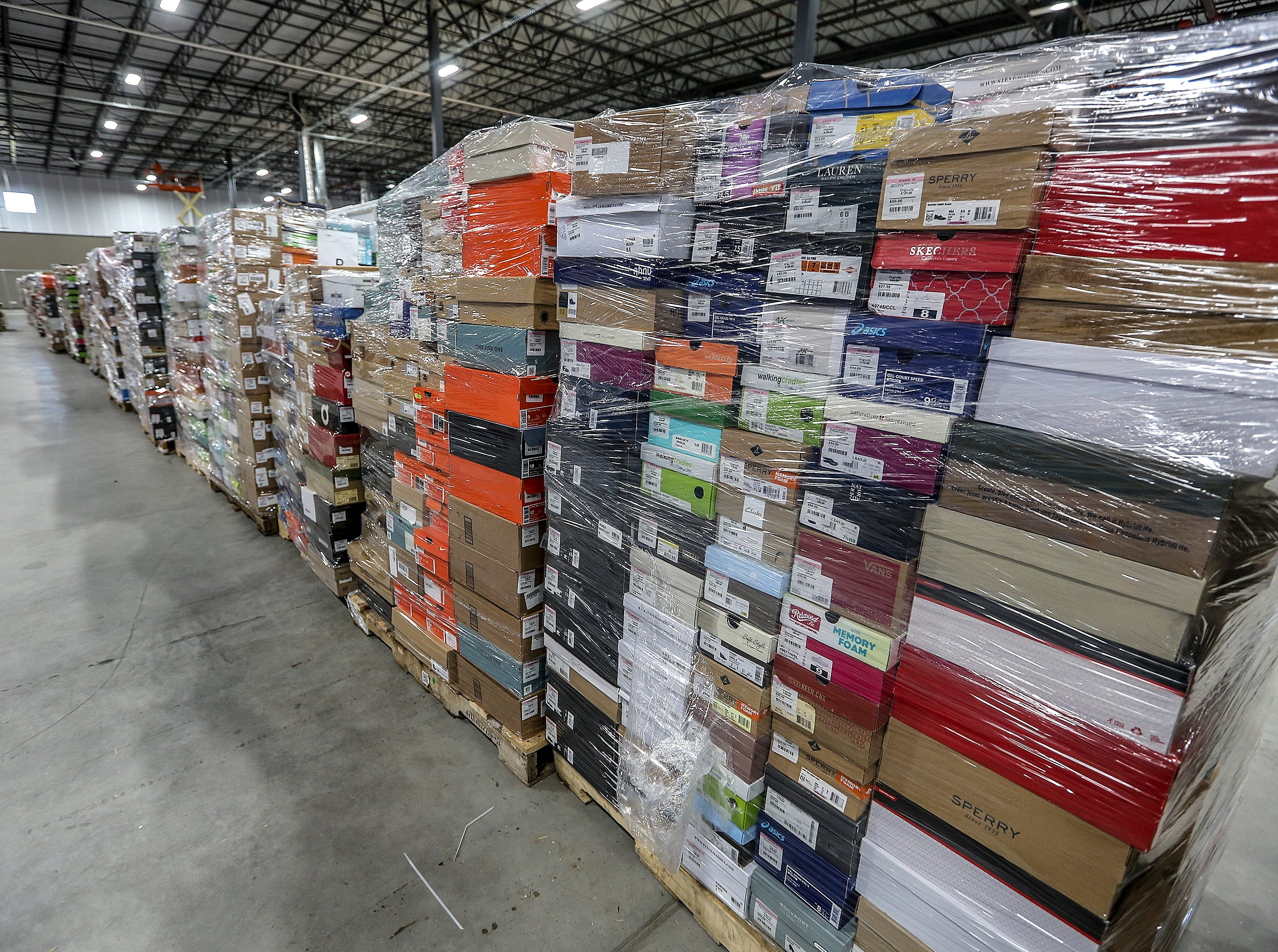 Tens of thousands of shoes are arriving at the new Zappos facility on Minors Lane.