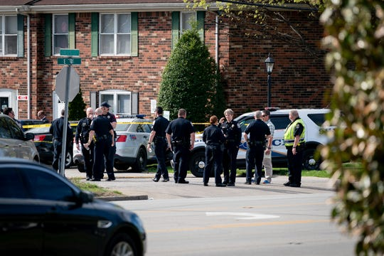 Louisville Metro Police investigate the scene of a shooting in the 4500 block of Gills Court in Louisville, Ky., April 9, 2019.