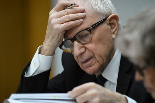 Attorney Mayer Morganroth looks through binders of paperwork Tuesday, April 9, 2019, while seated next to his client, former Michigan State University President Lou Anna Simon in District Judge Julie Reincke's courtroom in Charlotte, Michigan during the third day of Simon's preliminary hearing on four charges,  including two felonies for allegedly lying to police about when she knew about a sexual assault report against former MSU doctor Larry Nassar.   [Matthew Dae Smith/USA TODAY NETWORK/Lansing State Journal]