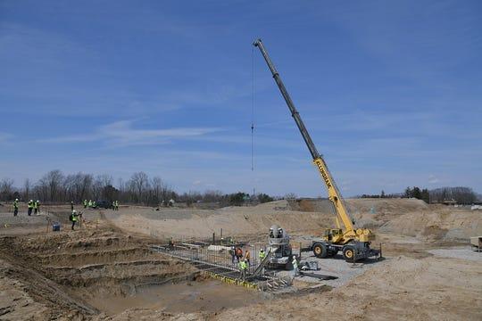 Concrete pour begins on $450 million new hospital project.