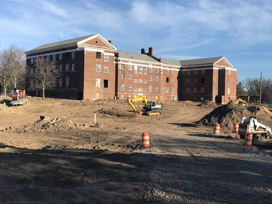 """This is a look at the west side of """"Old Main,"""" where parking spots for a 42-unit housing project will be built. The building sits just south of West Willow Street."""