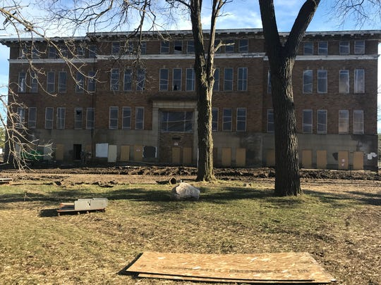 A developer plans to turn this former Michigan School for the Blind high school into 18 units of senior housing with 25 parking spots.