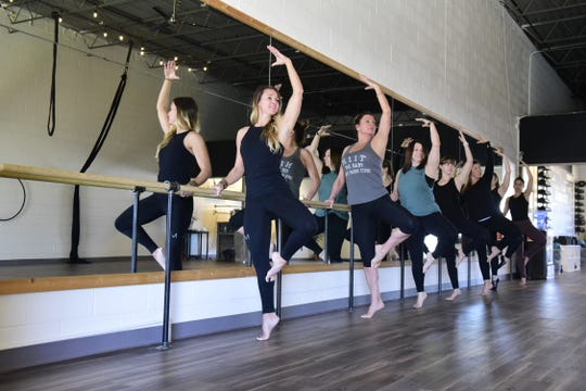 Carrie Aquino of Evolve Studios works out with a group of women in their new Lexington location.