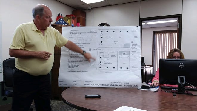 Tom Wade of Wade Gardens  Landscape and Gifts discusses plans for landscaping at the county courthouse.